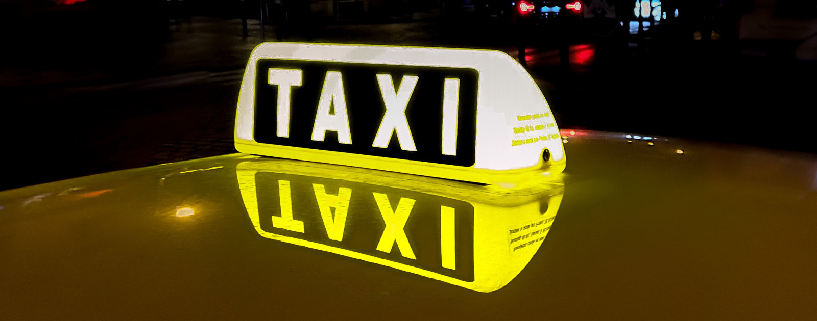 Dachbeleuchtung eines Taxis